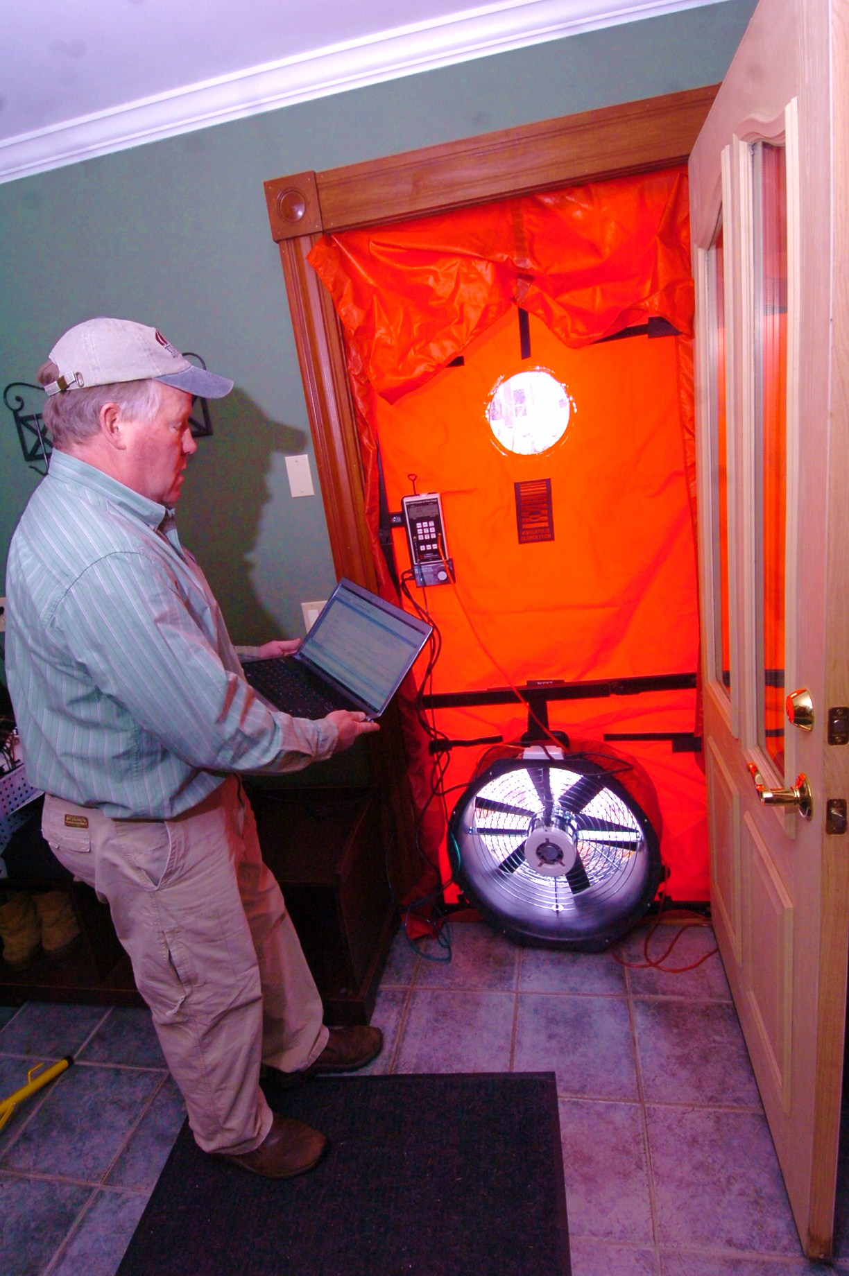 Setting up the blower door test.