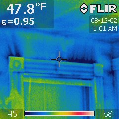 This thermograph shows cold air entering the building from behind the window trim during a Blower Door test.